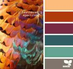 Jade/mint for walls, mahogany furniture, silver/pewter/platinum details, red, plum,  teal accessories, yellow for pop