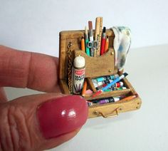 A very detailed miniature artist's paint box.