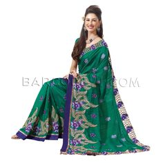 $142 Dark green tussar silk saree is with embroidery.It comes with dark green blouse piece.Slight variation is possible in color.