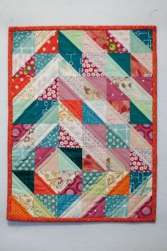 This would be a good doll quilt for Emmaline. Two inch HST squares would make a 12 by 16 inch quilt.