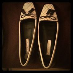 Leather loafers!!! Cream and black leather loafers with tassel design. Minimal wear. Minor scuffing on right shoe. Not noticeable at all. Size 8 Enzo Angiolini Shoes