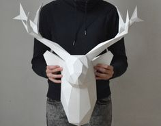 Low-poly animal paper heads for interior decoration