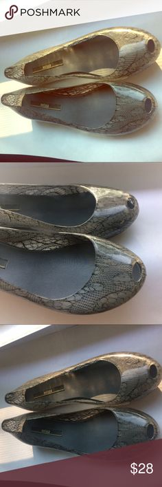 Melissa jelly shoes flats transparent gray Melissa jelly shoes flats transparent gray with Lacey inside finish. Excellent pre loved condition. No defects, no scratches. Incredibly comfortable! Worn <3 times. Melissa Shoes Flats & Loafers