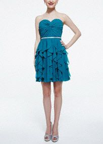 Stunning and chic, this twisted front beaded waist homecoming dress is the perfect choice for your special occasion!  Strapless bodice features chic twisted front detail and sparkling beaded waist.  Short cascading ruffle skirt adds dimension and movement.  Fully lined. Back zip. Imported polyester. Spot clean. Available in Plus sizes as Style 9560KG1W.