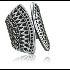 Boho Tribal FP/COW Ring Bohemian Tribal Silver Zinc Alloy Index or above the knuckle ring. Perfect for stacking to attain the Coachella, Free People/Child of Wild Flare. The ring on the Left Index Finger of the model in both photos is what is what is available here. I discount with bundles. My closet is set up to provide your Coachella Beach Time Fun Accessory needs that can be layered with this gem at an affordable price! Free People Jewelry Rings