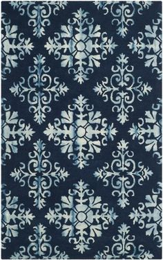 DDY720N Rug from Dip Dye collection.  From Safavieh's collection of Dip Dye Rugs, DDY720N is a classic navy blue floral tie-dyed carpet with a wool pile, twice-dyed for modern home decor.
