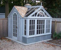 A timber-frame potting shed and greenhouse, made from reclaimed barn wood, chestnut barn beams, and salvaged glass by Micheal Fogg