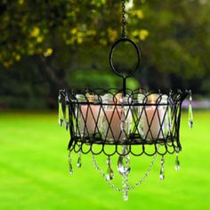 Homemade chandelier made from wire basket, canning jars and tea lights!