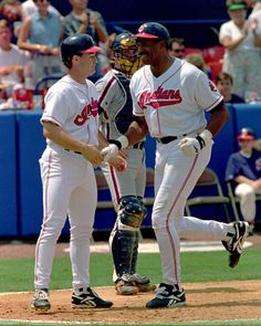 Cleveland Indians Dave Winfield is congratulated by Omar Vizquel as Detroit Tigers catcher John Flaherty watches after hitting a two-run home run in his first plate appearance as a Cleveland Indian at Chain Of Lakes Park in Winter Haven, Fla., Thursday, April 13, 1995