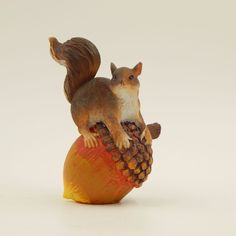 SOLD - Pre-owned decorative collectible resin squirrel figurine.  The brown squirrel is perched on an acorn with an upraised bushy tail.  This decorative figurine could be added to a collection or displayed for fall, autumn, Thanksgiving or similar harvest themed displays. #Squirrel #Figurine