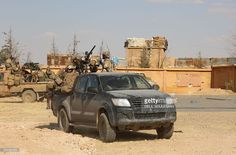 Armed men in uniform identified by Syrian Democratic forces as US special operations forces ride in the back of pickup trucks in the village of Fatisah in the northern Syrian province of Raqa on May 25, 2016. US-backed Syrian fighters and Iraqi forces pressed twin assaults against the Islamic State group, in two of the most important ground offensives yet against the jihadists. The Syrian Democratic Forces (SDF), formed in October 2015, announced on May 24 its push for IS territory north of…