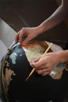 Easy, gorgeous DIY black & gold globe using craft paint and gold leave // Love & Renovations