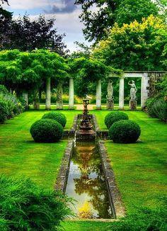 Formal garden with statues and pillars. #formalgarden homechanneltv.com