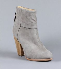The Stylish Boots Loved by Olivia, Rosie, Miranda, and More via @WhoWhatWear This classic suede boot, which comes in gray, brown, and black, as well as a textured canvas and glossy black leather version, is the ideal everyday boot. Celebs like Cameron Diaz, Rosie Huntington-Whitely, Heidi Klum, and Taylor Swift are often spotted wearing the comfortable Newbury style, which features a sleek, uncomplicated silhouette and chunky, stacked heel.