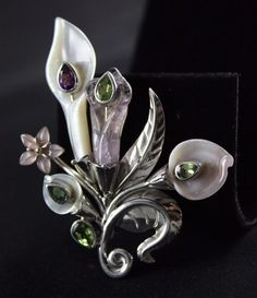 Elegant and gorgeous Sajen Lilies pendant. Stamped with Sajen and. 925 on the back. Top quality gemstones Amethyst, Peridot and. Blue Topaz add sparkling accents. pictures are of actual pendant you will receive.   eBay!