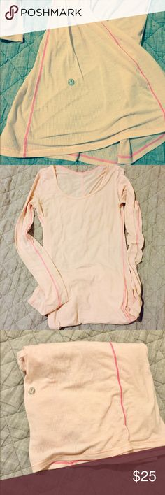 """Lululemon baby pink long sleeve tunic tee shirt Lululemon baby pink long sleeve tunic tee shirt. This is what I would call a """"ratty old tee,"""" but it Lululemon and I just can't bring myself to toss it in the rubbish bin. It's super cute and figure flattering even in it's less than perfect condition. Sold """"AS IS."""" No stains, just faded and a little pilling. But super cute and comfy and great layering piece. Size label gone but is a 2 or XS. lululemon athletica Tops Tees - Long Sleeve"""
