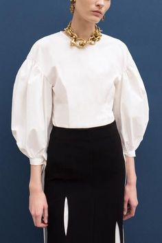 Puff Sleeve Blouse in Ivory Stretch Cotton Poplin. Voluminous sleeve with sleeve tie. Back zip fastening.SHOP THE LOOK:Kelsey Skirt / Marigold Heels Fashion Details, Look Fashion, Fashion Outfits, Womens Fashion, Fashion Design, Black And White Outfit, White Dress, White Shirts, Blouses For Women