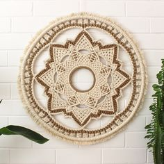 This intricately knotted wall hanging was carefully created over many hours and weeks, using the highest quality natural cotton and jute cord. With its symmetry and lotus flower motif, it will br. Macrame Art, Macrame Projects, Macrame Knots, Macrame Mirror, Diy Projects, Diy And Crafts, Arts And Crafts, Crochet Patron, Crochet Decoration