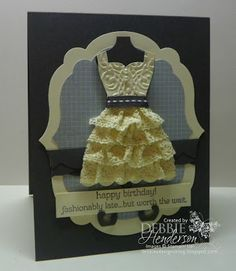 """Stampin' Up! Supplies:    Cardstock: Basic Gray, Very Vanilla   Inks: Basic Gray   Stamps: All Dressed Up   Tools: Big Shot Machine, Labels Collection Framelits, Dress Up Framelits, Large Scallop Edgelit, Sticky Strip, Stampin' Dimensionals, Lacy Brocade Textured Impressions Folder   Accessories: Basic Gray 1/4"""" Stitched Grosgrain Ribbon, Pearl Jewels, 5/8"""" Crochet Trim Victoria   DSP:Tea For Two"""