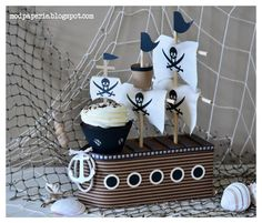 Thienly and her lil pirate had a fabulous birthday party with all the stuff she made using SVGCuts files!  Check out her blog for more designs and pictures and where to find all the info!  So awesome!  Click here:  http://modpaperie.blogspot.com/2013/04/a-ship-cupcake-holder-and-birthday-card.html