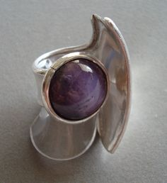 Open silver ring with star rubi