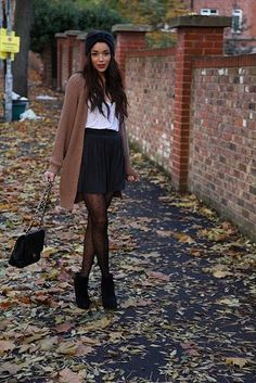 (For winter) black skirt sheer tights black booties loose tank tucked in with oversize sweater
