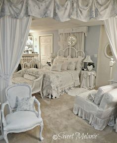 Gorgeously feminine bedroom decorated in the softest blue and white with hints of grey. Heavy use of soft furnishings and frills results in an ambience of old fashioned charm and romance.