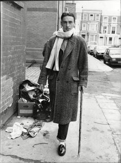 British musician Paul Weller wears an oversized herringbone tweed double-breasted coat, a nonchalantly-draped scarf, selvedge denim jeans and white socks with tassel loafers as he arrives to record. Band Aid 1984, The Man Show, The Style Council, Emeli Sande, Bob Geldof, Paul Weller, Look 2018, Boy George, Mod Fashion