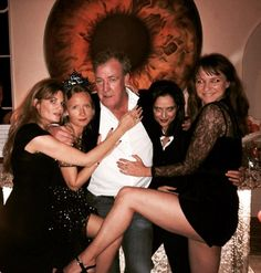 Looking bleary-eyed and clad in an open-necked shirt that did little to disguise his middleaged paunch, the former Top Gear host found himself set upon by a veritable harem of society¿s most eligible women