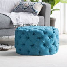 This Allover Tufted Round Ottoman features a dreamy teal hue that offers a splash of color and allover tufted textural appeal. $179.99 Sale $129.99. Free shipping. Buy here.