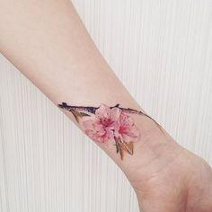 We love Sakura  #tattoo #flowertattoo #sakuratattoo #cherryblossomtattoo…