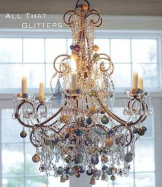 Chandelier decorated for Christmas.