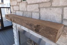 This mantel was milled from a piece of driftwood and the fresh cuts were stained to match the gray exterior.