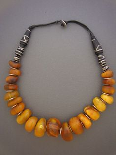 One of the nicest selections of Moroccan fossil amber beads we have ever come across, with silver discs and antique Mauritanian imam beads (from a strand of prayer beads). The imam beads have inlaid silver wire in the surface of the ebony wood. Amber Beads, Amber Jewelry, Tribal Jewelry, Boho Jewelry, Jewelry Art, Gemstone Jewelry, Jewelry Gifts, Beaded Jewelry, Jewelery