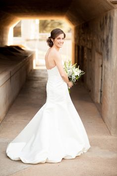 The back view of this wedding dress is just as beautiful as the front! There are so many styles of wedding gowns to choose from, but this bride's choice at her Fort Worth, Texas bridal session was gorgeous. #weddinggown #weddingdress #texasbride #texaswedding #fortworthwedding
