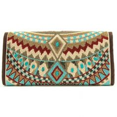This trendy clutch is the perfect accessory to pull together any outfit. The eye catching tribal print on this clutch features turquoise, bordeaux and mustard yellow beading and hand-laid glass. The Turquoise stone is celebrated as a symbol of friendship and acknowledged for promoting positive energy. Soft structured form, cross-body chain strap, magnet closure and 1 interior pocket. - Handbags & Scarves - National Cowboy Museum