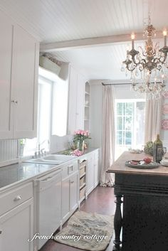 The kitchen is long and has 2 very small windows originally. They were replaced with larger ones to allow more light to come in.