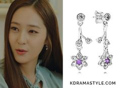 Moo Ra(Krystal 크리스탈) wears silver drop earrings with purple flowersin Episode 16 of Bride of the Water God. They are thePandora Forget Me Not, Purple & Clear CZ. Get themHERE for $90. Available from: Pandora– $90  See more of...