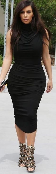 Who made  Kim Kardashian's black ruched dress and beaded sandals that she wore in Los Angeles on April 17, 2014?