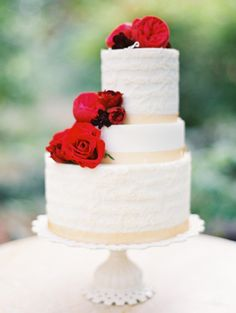 Off Center Tiered Cake With Red Roses | photography by http://erichmcvey.com/ | creative direction by http://www.projectwedding.com/ | floral and event styling by http://www.petalosdesign.com/ | cake design by http://www.sugarhousecake.com/