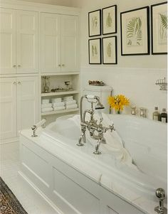 Everything about this bath is grand, right down to those luscious-looking, glass-ensconced salts. A too-small amateur faucet would have killed the look!