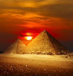 stock photo of great pyramids - Pyramids in Giza valley under sunset light - JPG