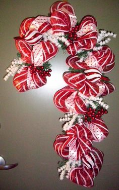 Deco Mesh Wreath - How To Deco Mesh and Ribbon Candy Cane Christmas Wreath.ribbon candy cane, gotta get momma to make me one of these next year!Ribbon Candy Cane - I don't need no stinkin' etsy!ribbon candy cane would be pretty on my green door! Wreath Crafts, Christmas Projects, Holiday Crafts, Holiday Fun, Wreath Ideas, Christmas Ideas, Holiday Quote, Holiday Candy, Thanksgiving Holiday