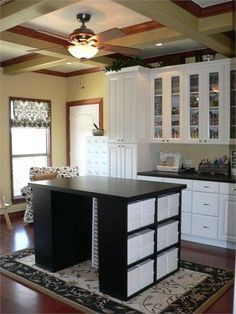 Craft Room - like this island.  Bookcases on the end.  Top could be more challenging.  Link has no info.  Maybe an Ikea hack?