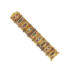 A Gold, Colored Stone, Diamond and Enamel Bracelet, designed as a series of hinged panels, each panel applied with white enamel spot details, set with emeralds, rubies, sapphires and pink sapphires, further set with old mine-cut diamonds weighing aprox. 1.00 carats, length 8 in. , with maker's marks; circa 1870. | via Sotheby's