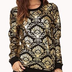Black Sweatshirt w/ Gold Designs Shirt is very comfortable, and looks great dressed up or down! Tops
