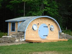 Two-room hobbit hole home with screened back porch in Unity, Maine. Photos and build by Wooden Wonders.