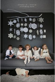 snowflake branch.  Use as photobooth backdrop.  Longer strands with gray paper/gray crepe in back.