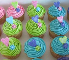 Vanilla cup cakes with colourful butter cream icing