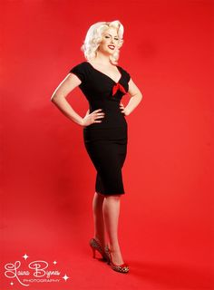 Natalie Dress in Black with Red Trim by Pinup Couture - Our sexy Natalie pinup creation is one of our favorite new styles. The Natalie dress is cut to hug every one of your dangerous curves, but still be impossibly comfortable. It has the most basic design that you can dress up or down for any event. Perfect for any season this dress features include cute trimmed cap sleeves, a vintage inspired